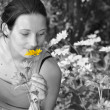 Woman smelling flowers. — Stock Photo #8552027