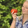 Woman with tomato. - Stock Photo