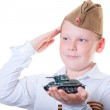 The boy is holding a plasticine model of the tank — Stock Photo