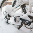 Bikes covered with snow - Stock Photo