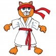 Cartoon cat in karate outfit - Stock Vector