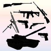 Silhouettes of weapons - vector — Stock Vector