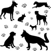 Dogs silhouettes - vector — Stock Vector