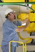 Telecom Switch Worker inspecting Fiberoptic Cables — Stock Photo