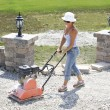 Compacting Lady - Stock Photo