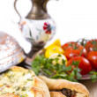Turkish Pide garnished with vegetables — Stock Photo
