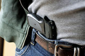 Pistol hidden in belt — Stockfoto