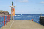 Eyemouth harbour entrance and light on pier, Berwickshire — Stock Photo
