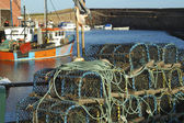 Lobster pots and trawlers at Dunbar harbour — Stock Photo
