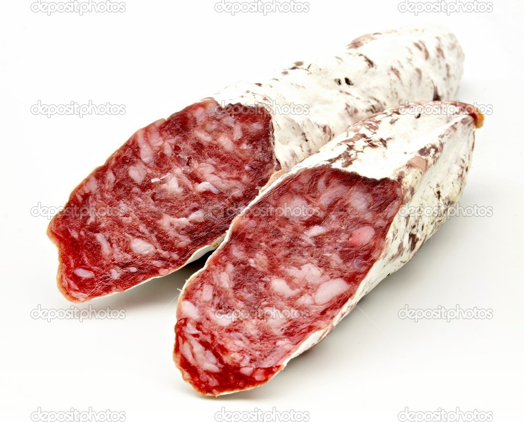 Several pieces of Salchichon next to each other surrounded by white background — Stock Photo #10489566
