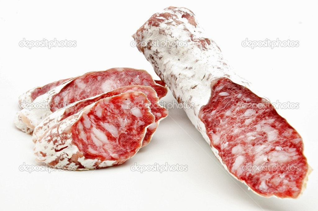 Several pieces of Salchichon next to each other surrounded by white background  Stock Photo #10489742