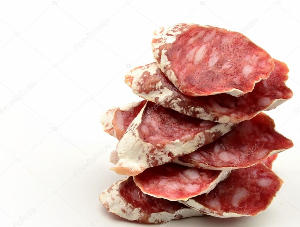 Several slices of Salchichon next to each other surrounded by white background  Stock Photo #10489850