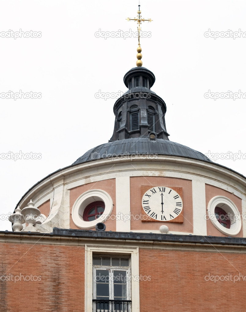 Dome with clock and a cross on top at the Royal Palace of Aranjuez located in Spain  Stock Photo #10539035
