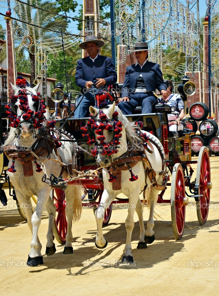 In carriage horses walking in the royal house of the fair on the horse fair the day May 12, 2012 in Jerez de la Frontera, Spain  Stock Photo #10558364
