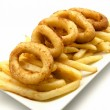 Plate of squid and chips - Stock Photo