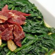 Spinach stew with ham and garlic - Stock Photo