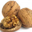 Three walnuts in closeup on a white background — Stock Photo