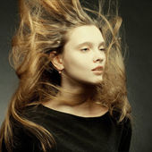 Beautiful girl with a flying hair — Stock Photo