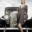 Elegant girl poses near retro car - Stock Photo
