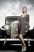 Elegant girl poses near retro car — Stock Photo