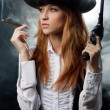 The beautiful girl in hat, with a revolver — Stock Photo