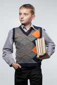 Little boy with books in hands — Stock Photo