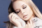 Closeup of the beautiful girl clung to fur — Stock Photo