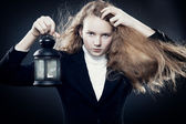 Beautiful young girl bears a lantern — Stock Photo