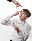 Boy rubs a forehead after blow — Stock Photo