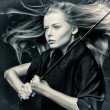 Closeup of beautiful girl with sword. — Stock Photo #9102121