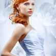 Beautiful girl in wedding dress with creative hair. — Stock Photo