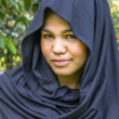 Indonesian moslim girl in a black scarf — Foto de Stock
