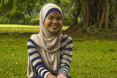 Indonesian girl in the park smiling — Stock Photo