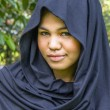 Indonesimoslim girl in black scarf — Stock Photo #9635102