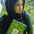 Stock Photo: Indonesigirl holding quran
