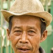 Indonesian old man in hat - Stock Photo