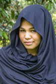 Indonesian moslim girl in a black scarf — Stock Photo