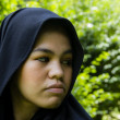 Indonesian moslim girl in a black scarf — Stockfoto