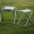 Canvas chair on green grass — Stok Fotoğraf #10425130