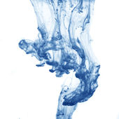Blue ink spreading in the water — Stock Photo