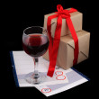 Christmas still life with wine and gifts - Stock Photo