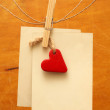 Vintage photos and red heart hanging on the clothesline — Stock Photo