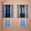 Stock Photo: Old windows with shutters in Nice