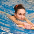 Young girl is swimming — Stock Photo #7982411