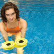 Woman in water with dumbbels — Stock Photo #7982479