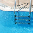 Handrail in swimming pool — Stock Photo