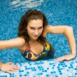 Beautiful girl in swimming pool — Stock Photo