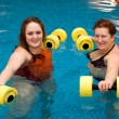 Mum with a daughter in aqua aerobics - Stock Photo