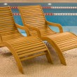Stock Photo: Empty seats for rest near to pool