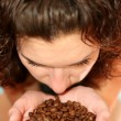 Royalty-Free Stock Photo: The girl smells aroma of coffee grains